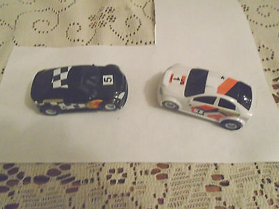 Two Micro Scalextric Rally Cars