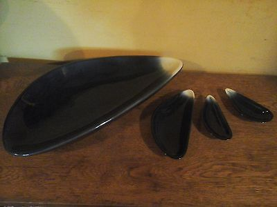 Extremely unusual set of four vintage mussel shaped pottery bowls