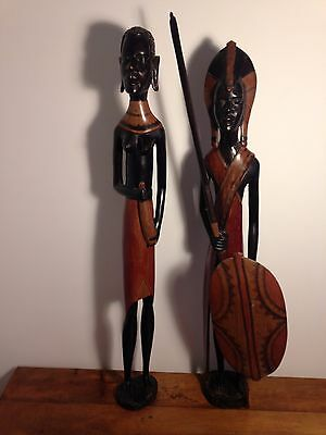 Tall African man and woman carved figures, tribal