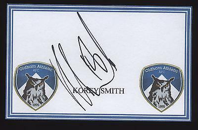 Korey Smith signed Oldham crested card.
