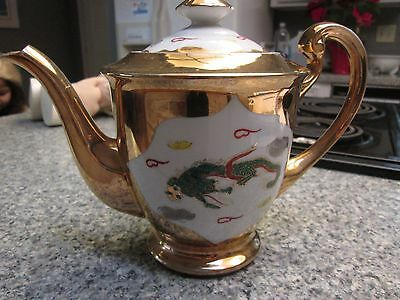 asian porcelain teapot with gold
