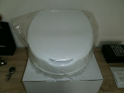 """Disabled 4"""" Raised Toilet Seat with Lid New in Box"""