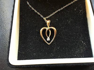 "9 ct Gold Double Heart Pendant with  7 pt Diamond and 18"" Chain"