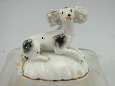 AN ENGLISH STAFFORDSHIRE PORCELAIN FIGURE OF A POODLE 19thC
