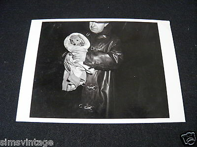 Unusual Weird Postcard Man with puppy wrapped up warm. Police Fire etc ???