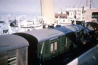 SR 52 R1 1154 in olive green arrives at Folkestone Harbour with a boat train 193