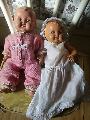 TWO VINTAGE COMPOSITE BABY DOLLS WITH CLOTHING 1930s