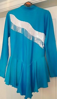 Figure skating dress. Size 3 (approx size 6-8). Boot covers included.