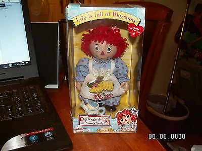 NEW Raggedy Ann Porcelain Doll Brass Key Keepsake Life if Full of Blossoms LOOK!