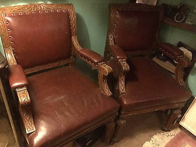 Pair of hand carved jacobean chairs