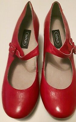 Red leather shoes by Schuh size 5