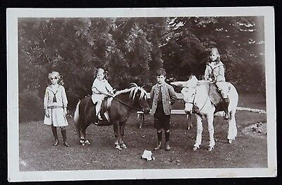 Nice Vintage Real Photo Postcard of Four Children and Two Ponies