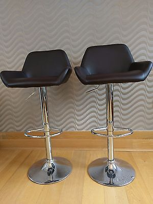 Pair of brown faux leather chrome gas lift bar stools adjustable height