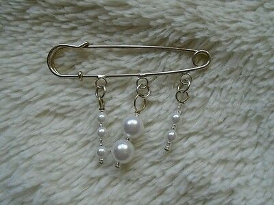 Silvertone safety pin brooch with white faux pearls