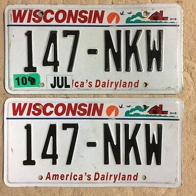 Pair of 2010 Wisconisn farm graphic License Plate Plates # 147 - NKW