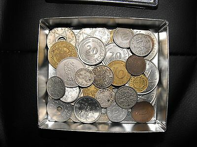 Assorted coins in Farrah's Harrogate Toffee tin,