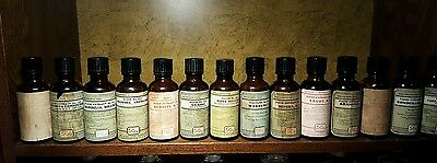 Lot of 14 antique Eli Lilly pharmacy bottles from early 1900s