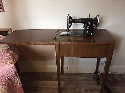 Vintage Harris Electric Sewing Machine on Wooden Table