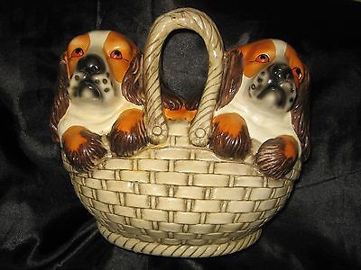 Pair of Spaniel (?) dogs in basket ~Pottery