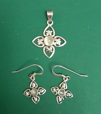 sterling silver 925 earrings and matching pendant (no chain). pristine
