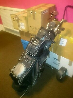 golf bag, clubs, balls and a buggy