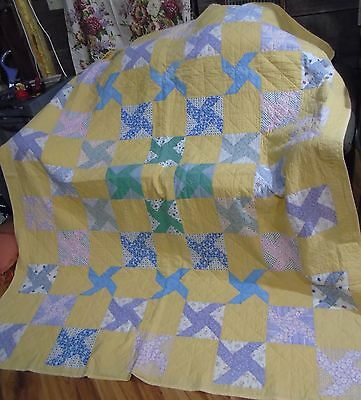 Vintage  hand quilted Quilt  in Wind Wheel Pattern very old fabrics good conditi