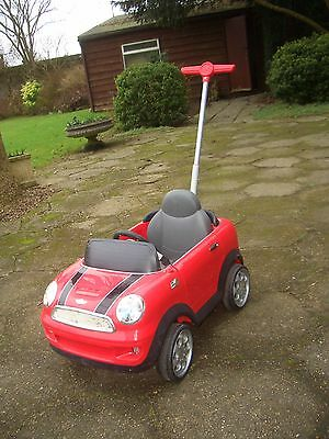 Red mini Cooper outdoor push along ride in children's toy car, with handle
