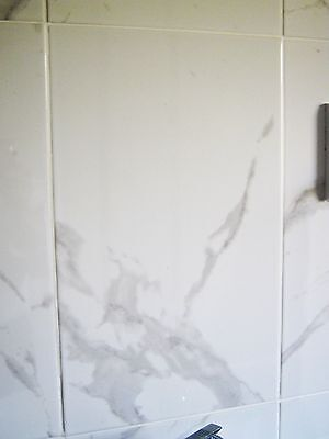 New Rhodes gloss white marble effect wall tiles 33.3x55cm TWO packs of 10 each.