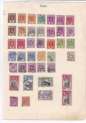 Ceylon - 120+ on old album pages includes GVI 5Rs      -  17/165