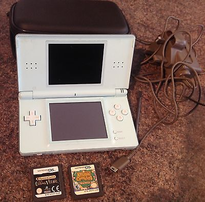 Pale Blue Nintendo Ds Lite Console With Adapter, Case & Games