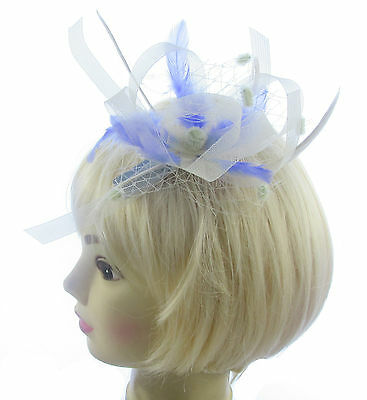 Cream net and feather fascinator with lilac mounted on a comb , weddings, prom