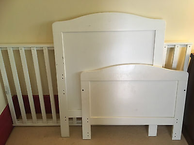 White wooden cot bed