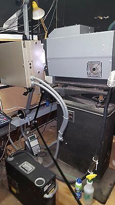 Vintage 35mm cinema film projector with extra parts/accessories