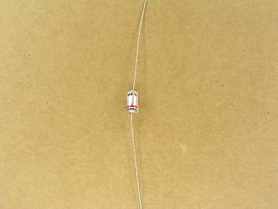 S00958A (5 Pc Lot) 100 pf 125 volt 125V +- 10 % axial polystyrene capacitor