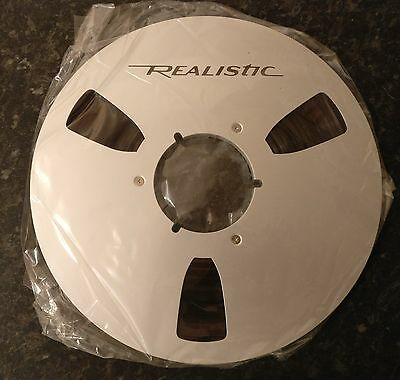 """Brand new Realistic 10.5, 10 1/2"""" x 1/4"""" Reel with Tape"""