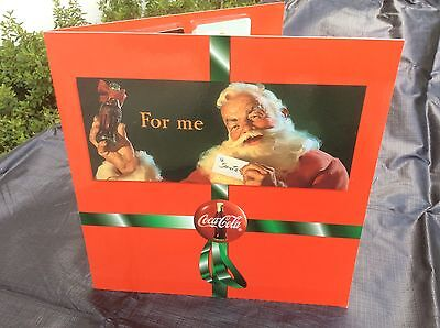 Coca Cola 1995 limited edition Christmas phone card set by score card