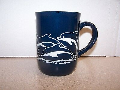 """Beautiful blue embossed """"Dolphins riding Waves"""" ceramic tea/coffee cup"""