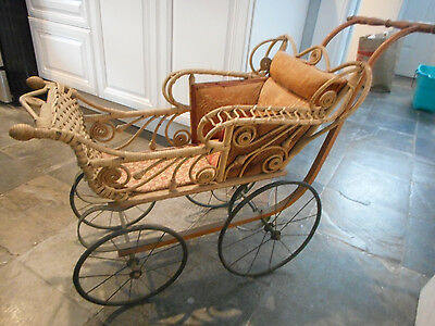 Real nice antique doll size carriage, great condition!