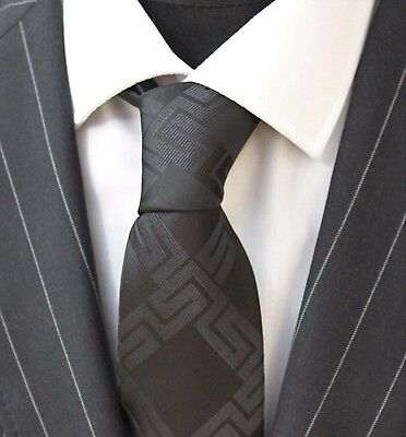 Tie Neck tie with Handkerchief Black with geometric pattern.