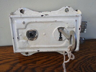 Vintage reclaimed rim lock with key, white painted metal, outhouse, toilet