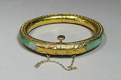 A Very Fine and Rare Chinese 24K Gold Mounted Jadite Bangle Bracelet