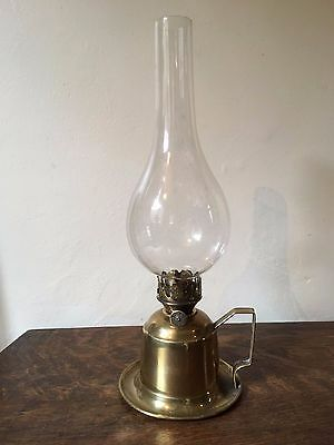 Vintage / antique. Brass hand oil lamp with glass chimney.