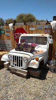 Vintage jeep front end car and truck art restaurant business decor road relics
