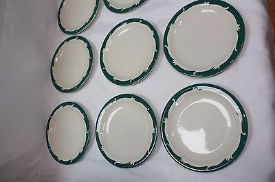 Set of 12 Syracuse china saucers