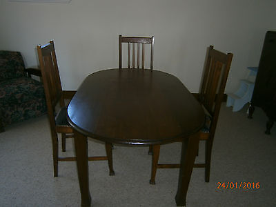 Dining  table oval  with 4 chairs,  Art Deco style.