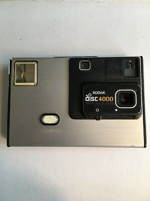Vintage Kodak Disc 4000 Camera.  As is for parts or repair With 1 Disc