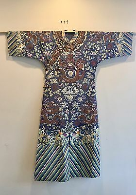 An embroidered Chinese blue silk ground dragon robe