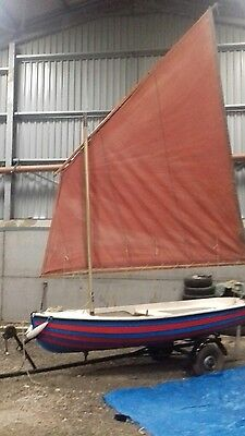 Sailing dinghy and trailer.