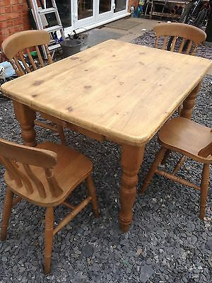 Pine Wood Table And Four Chairs