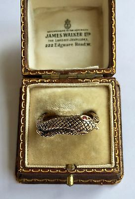 A Stunning Gold Black Enamel Snake Ring Set With Ruby Eyes Circa 1800's